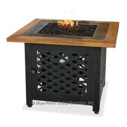 Blue Rhino - Uniflame Gas Outdoor Firebowl - Blue Rhino GAD1391SP Liquid Propane Outdoor Firebowl with Slate and Faux Wood Mantel ...This Blue Rhino outdoor firebowl is a beautiful functional and modern addition to any deck patio or pool side. Offering more than 30 000 BTU's and powered by liquid propane there is no limit to where this stylish and customizable unit can travel and safely provide comfort. This unit features handcrafted slate tile and faux wood mantle in a circular design with a covertly hidden control panel that keeps everything within arms reach. Includes Bronze Glass. Simple assembly with no tools required makes this one of the most versitle and easy to use additions to any home.