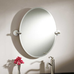 "24"" Houston Oval Tilting Mirror - A perfect finishing touch to a classic bath, the 24"" Houston Oval Tilting Mirror has a beveled edge and is held by two rounded brackets on porcelain bases."