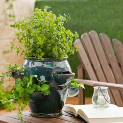 Round Ceramic Coralbell Strawberry Jar With 6 Pockets - This herb garden could easily find its way into a kitchen corner or sit comfortably outside. It's intended for strawberries, but it would work perfectly well for herbs too.
