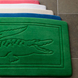 Lacoste Bath Rug - The eternally preppy now have a bath rug to show their allegiance to the youthful and conservative style. And for guests who aren't familiar with the Lacoste branding, the big green alligator could serve as a humorous approach to bathroom decor.