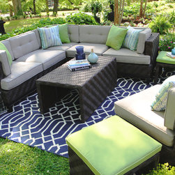 Canyon Outdoor Sectional - Classy and comfy. The Canyon Collection exudes class with its modern casual seating balanced by a beautiful herringbone wicker weave. The coffee table has two additional seating stools stored underneath for when extra friends show up. The modern colors of the Sunbrella throw pillows add even more fun. So it's modern, classy, casual, comfy and fun. No matter where your friends come from, they'll feel right at home on this one.