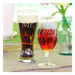 "Cathy's Concepts - Mr. & Mrs. Pilsner Glasses - As the newly married couple, let these custom Mr.& Mrs, pilsners be the perfect match for all toast-worthy occasions. This pilsner set complements any table setting and creates a super trendy set every couple can enjoy. His pilsner glass is a sharp silhouette of clear masculinity, while hers is a reflection of soft curves. Featuring fine hand-blown glass and sturdy bases, these beer glasses are the ideal touch of custom charm and make an impressive addition to any home bar. * Dimensions for his pilsner: H: 8.5"" D: 3.5"" capacity: 20 ounces * Dimensions for her pilsner: H: 7.85"" D: 3.75"" capacity: 16.5 ounces"