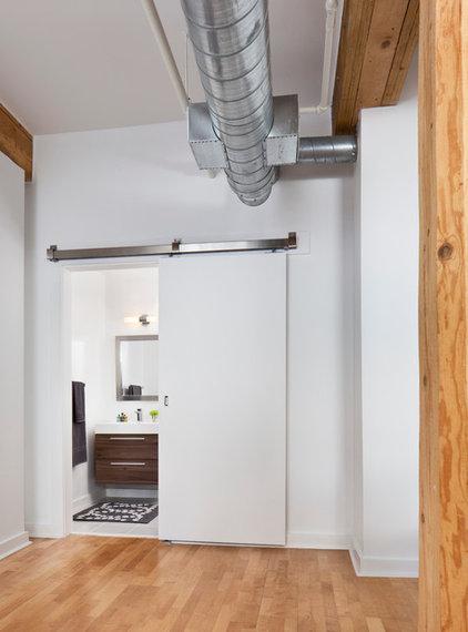 Industrial Bathroom by Rad Design Inc