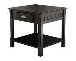 "Winsome - ""Winsome Wood End Table with Drawer & Shelf, Black"" - ""Blending rustic style with modern tailoring, this end table makes a distinctive solo statement or adds the finishing touch to Winsome Wood's matching hall and coffee tables. The roomy tabletop features a bevel-edged square shape with a wide apron that hosts a storage drawer and plank-inspired paneling. Below, the chunky rectangular legs are carved on the outside corner for airy elegance, and the open shelf displays collectibles, showcases large books, or holds a small fern. Crafted of solid/composite wood and finished in rich black with a half-moon brushed chrome drawer pull, this piece is classic enough to stay in style no matter how the furnishings around it change. It measures 22 inches in diameter by 22 inches high; some assembly is required.Dimensions (W x L x H): 21.97"""" x 22.05"""" x 21.97""""Weight: 33 lbs.Country-inspired end table offers rustic yet modern tailored styleCrafted of solid beechwood with rich black finish; brushed chrome door pullStorage drawer and open shelf; paneled sides and simple carved legsSome assembly required; measures 22-inch in diameter by 22-inch highMatching hall and coffee tables available"""