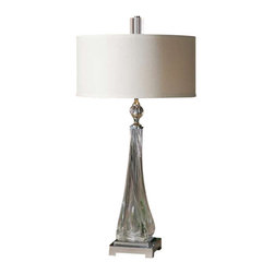 Uttermost Grancona Twisted Glass Table Lamp - Thick, twisted glass base with polished nickel details and crystal accents. Thick, twisted glass base with polished nickel details and crystal accents. The round, hardback drum shade is a off white linen fabric.