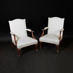 """English Georgian America - Chippendale Gainsborough Chairs - This handsome carved mahogany library or """"Gainsborough"""" armchair has a gently curving back and shaped arms which have acanthus leaf carved scrolled handles and leaf carved moulded supports.    The padded seat is raised on moulded cabriole legs decorated with carved cabuchons, leaves and scrolls and strand on tightly scrolled toes."""