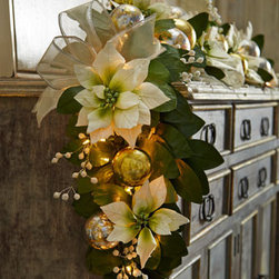 "Horchow - Poinsettia Garland - Exclusively ours. Traditional prelit poinsettia garland featuring foliage and flowers mingled with silver and gold ornament balls and embellished with sheer ribbon brightens up a mantel or doorway. Handcrafted. Prelit with 100 lights. 72""L x 8.5""..."