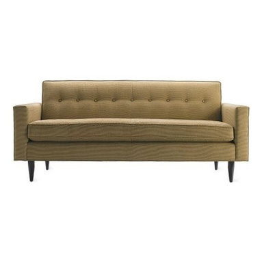 Design Within Reach - Bantam Sofa - A soft, less machined brand of modernism first arose in the United States in the 1930s and it was aimed at simplifying life by comfortably modernizing it. Our Bantam Collection (2004), which builds in comfort across the entire surface of each piece, takes its inspiration from this period while taking advantage of more recent technical advances. Influenced by the furnishings of Edward J. Wormley, the Bantam Sofa delivers supreme physical comfort as well as aesthetic pleasure. Made in U.S.A. Premium foam padding covers the entire frame to create a softly rounded profile that is both visually pleasing and sophisticated. Precision cut wooden frame with corner-blocked interlocking joints for stability and strength. Tapered solid wood legs available in coffee, walnut or honey stain. DWR Exclusive.