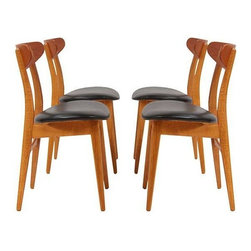 "Hans Wegner - Pre-owned Danish Modern Dining Chairs by Hans J. Wegner - Can you say ""Classic!""? A set of 4 Danish modern dining chairs, Model CH-23, designed by Hans Wegner and manufactured by Carl Hansen & SĚün. Circa 1960s Denmark. These chairs have been newly refinished and reupholstered, and are in excellent vintage condition. They're made of teak, oak, and leather. Would look smashing surrounding a Saarinen tulip table!"