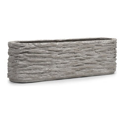 iMax - Thorpe Oval Planter - With a texture inspired by natural rock, the Thorpe wide oval planter features a slim line shape great for trailing foliage or faux florals arrangements.