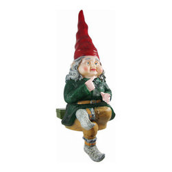 ZELDA Glowing Gnome Solar Garden Sitter Statue - The Gnomes Of Toad Hollow are a collection of garden gnomes that add whimsy and imagination to your garden or patio. This gnome, named Zelda, is a sitter gnome, and can be placed on tables, birdbaths, pond walls and window boxes. Zelda is solar powered, and a clear LED in the bottom turns on automatically in dark conditions, making her body glow warmly, lasting up to 10 hours under a full charge. Made of cold cast resin, the gnome measures 12 inches tall, 9 inches wide and 5 inches deep. She`s hand-painted, and shows great detail. She makes a wonderful gift for any gnome collector lover.