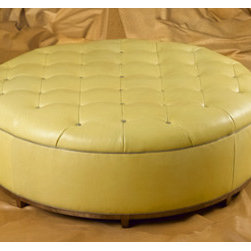 L127 OTTOMAN by Wesley Hall - This large and tufted circular ottoman is a wonderful piece to center four chairs around or add a circle with a large sectional. Place a tray on top to transform it into a cocktail or coffee table.