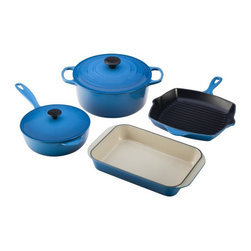 Le Creuset - Le Creuset 6 Piece Signature Set - Marseille - MS05196-59 - Shop for Cookware Sets from Hayneedle.com! You'll love the form and function of the Le Creuset 6 Piece Signature Set - Marseille. Perfect for newlyweds or anyone looking to outfit their kitchen this cast iron collection equips your kitchen with the essentials. Each pan features large handles to ensure a good grip while wearing oven mitts superior heat distribution and retention and a chip- and crack-resistant finish. It's safe for your oven broiler microwave and freezer and won't absorb odors or flavors either. Plus cleanup is a breeze as each piece is dishwasher-safe. Set includes 5.5-qt. round Dutch oven with lid 2.25-qt. saucier with lid 10.25-in. square skillet grill and 2.5-qt. roasting pan.About Le Creuset of America Inc.From its cast iron cookware to its teakettles and mugs Le Creuset is a global standard of inimitable color and quality. Founded in 1925 in the northern French town of Fresnoy-Le-Grand Le Creuset still produces enameled cast iron in its original foundry. Its signature color Flame was modeled after the intense orange hue of molten cast iron within a cauldron (or creuset in French) and has been a Le Creuset bestseller from the company's first year to the present day.Though best known for its vibrantly colored cookware and original inventions such as the Dutch oven Le Creuset has also forged a name as a creator of stoneware mugs and enamel-coated stainless steel teakettles. The style and performance of Le Creuset's Cafe Collection and tea accessories are rooted in classic French cookware: bold colors cylindrical loop handles unmatched thermal resistance and heat distribution and of course the iconic Le Creuset three-ring accent. Through its consistent qualities of authenticity originality and innovation Le Creuset maintains a connection to both heritage and modernity.