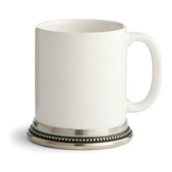 Perlina Mug - The simplicity of tankard-like lines takes on a fresh, breezy charm in this elegant Perlina Mug, a simple combination of white ceramic and hand-finished antique pewter that lends a European feel to casual or formal drinks and dining.  Clean white glaze is versatile and bright, while the beaded texture that rings the pewter foot of the mug is a simple universal design.