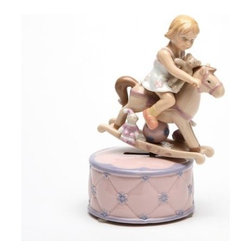 CG - 7.125 Inch Girl Riding Rocking Horse on Pink Box Ceramic Figurine - This gorgeous 7.125 Inch Girl Riding Rocking Horse on Pink Box Ceramic Figurine has the finest details and highest quality you will find anywhere! 7.125 Inch Girl Riding Rocking Horse on Pink Box Ceramic Figurine is truly remarkable.