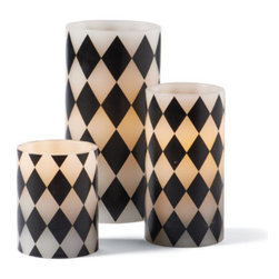"""Grandin Road - Harlequin Battery Operated Candles - 3"""" x 6"""" - A single, optional remote will control an entire room full of candles (sold separately). Crafted from real white wax, wrapped in harlequin-print vellum, our candles provide all the atmosphere you would expect, without the worry of an open flame. LED turns on and off, manually, or use the automatic 4-, 6-, or 8-hour timer function. Up to a 500-hour battery life. Requires four AA batteries each (not included). Our Battery-operated Harlequin Candles are perfect for adding a touch of flickering ambience to your Halloween ball, but the real magic is in the remote.  .  .  .  .  . A Grandin Road exclusive."""