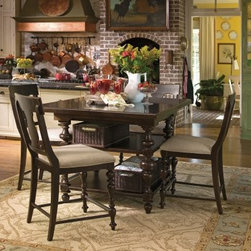 Paula Deen Down Home Gathering Table with 2 Baskets - Tobacco - Luxurious Southern hospitality comes home with the Paula Deen Down Home Gathering Table with 2 Baskets - Tobacco. Elegantly turned legs lend an heirloom quality and the spacious tabletop includes a center leaf that extends out when company comes over. This table features two solid shelves beneath and two generous wicker baskets that make great use of storage space. This table is crafted of gorgeous rustic knotty cherry veneers and select hardwoods in a dark tobacco finish.About Universal Furniture InternationalRecognized as a leader in exceptionally crafted home furnishings, including bedroom and dining room items, entertainment centers, and more, Universal strives to make items that are styled to endure but always remain fresh. They make it a goal to include features that fit the way their customers live today, and to find prices that put high-quality products within reach. These are the principles that guide the work at Universal, essential elements of good, affordable, and smart design.