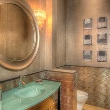 Mediterranean Powder Room by MJS Inc. Custom Home Designs