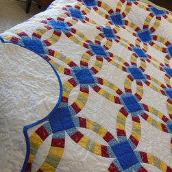 Summer Garden Hand-Quilted Double Wedding Ring Quilt by Bluebird Gardens - I tend to favor pastels in my quilts, but the combination of these primary colors caught my eye. The traditional circle pattern (often used for wedding quilts) is so pretty, and I love the combination of blue, red and yellow. It would look fantastic in a little boy's bedroom.
