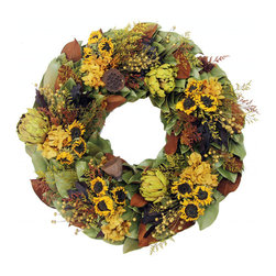 "Season in a Trunk - Golden Sunflowers Wreath, 18"" - Gorgeous hues of golden hydrangeas, yarrow and wheat mingle with vibrant aubergine celosia to create our most stunning dried magnolia wreath yet! Chocolate canella berries and lotus pods add depth while mini pumpkins add a festivity to this harvest season."
