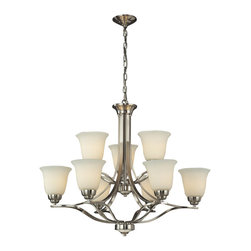 Elk - Malaga 6+3 Light Chandelier in Brushed Nickel -LED's Offering up to 7,200 Lumens - With clean and flowing style, this series has sophisticated double arm construction with a subtle arch that gracefully supports flared glass. A choice of finishes include brushed nickel with opal white glass or aged bronze with antique amber glass.