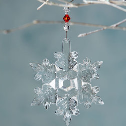 """Waterford - 2014 Snow Crystal Christmas Ornament - Waterford2014 Snow Crystal Christmas OrnamentDetailsMade of cut lead crystal with a hole in the center.Includes 3""""L jeweled ornament hanger and a removable 2014 hang tag.4.25""""Dia.Imported.Designer About Waterford Crystal:Established in 1783 Waterford crystal is cherished around the world for its rich tradition of craftsmanship and artistry. Each piece from stemware to decorative items is still mouth blown and handcrafted by master artisans. A customary gift to royalty and heads of state a treasured heirloom for generations."""