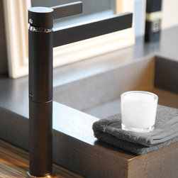 MaestroBath - Black Bathroom Faucets by MaestroBath - A perfect example of the modern and elegant design you have come to expect from Maestrobath products. Inspired by abstract designs of modern architecture, Caso uses familiar shapes, rectangles horizontally and cylinders vertically. Yet, this contemporary design is extremely functional with different types of settings in mind. This high end designer Italian bathroom faucet is comprised of two pieces. The bottom piece can optionally be removed to lower the height of this luxury faucet if needed. A single handle valve is also incorporated for further ease of operation.