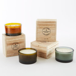 Recycled Glass Candle - These beautiful scented candles come in recycled glass votives and are packed into little wooden boxes, making them an ideal gift for men. They come in various fragrances and are great for modern, urban homes.