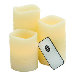 "Benzara - Attractive Cream Shaded Led Wax Candle Remote Set - Introducing this amazingly styled Led Wax Candle Remote Set that will brighten your interiors. This Led Wax Candle Remote Set is made of quality materials that will last for long. The Led Wax Candle comes with a remote that will allow you to light the Led Wax Candle else turn it off whenever needed without really going all the way near Led Wax Candle. You can add this attractive Led Wax Candle to your bedroom, living space, dining table else a place of your choice. This Led Wax Candle Remote Set can also be used to light up professional space too.Besides, you can wrap this beautiful Led Wax Candle Remote Set to gift your near and dear ones. Own it else gift Led Wax Candle Remote Set, choice is yours. Led Wax Candle Remote Set measures 3 inches (W) x3 inches (L) x6 inches (H), 3 inches (W) x3 inches (L) x5 inches (H), 3 inches (W) x3 inches (L) x4 inches (H); Cream color palette; Comprises of a remote; Dimensions: 14""L x 7""W x 18""H"