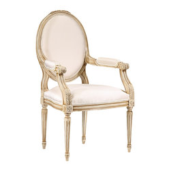 "Inviting Home - Louis XVI Style Armchair - Louis XVI style arm chair with antiqued white finish; overall dimensions: 24-1/2""W x 22-1/2""D x 43""H; seat: 24-1/2""W x 22-1/2""D x 19-3/4""H; back: 43""H; arms: 28-1/2""H; hand-crafted in Italy; Louis XVI style carved beech wood chairs with antiqued white finish and off-white upholstery. These carved wood chairs are hand-crafted in Italy."