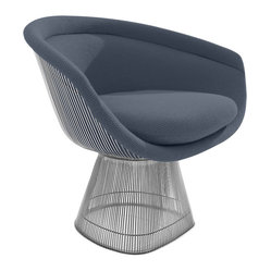 Knoll - Platner Lounge Chair - No needle in this haystack! The eye-catching steel wire haystack base of this iconic 1960's lounge chair only looks wispy and delicate. Covered in a warm boucle fabric this mod lounge chair is as expansive as a throne with the well-rounded comfort you want for your cozy castle.