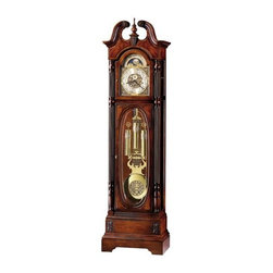 "Howard Miller - Howard Miller - Stewart Floor Clock - Minutes glide from stoke to stroke in this masterfully crafted, celebratory, cherry grandfather clock featuring Kieninger Concerto Chimes, embellished rosettes, coordinating keystone finial support, rich mahogany accents and other reliable artisan fixtures to invigorate your room's d̩cor with infinite luxury. * In celebration of Howard Miller's 75th Anniversary. . This beautiful floor clock features an elegant swan neck pediment accented with decorative rosettes and matching keystone finial support, a turned finial, and crotch-figured mahogany. . A special cast dial offers elaborate corner spandrels and center disc and an astrological blue moon phase. . The crotch-figured mahogany continues on the top and bottom corners of the door which features crystal-cut, V-groove, oval glass. . An illuminated case highlights the brass pendulum and weights that feature a decorative cast pendulum bob and matching weight bands. . Complimenting overlays accent the multi-tier base which supports reeded columns with turned column caps. . Concerto movement plays Westminster chime, in. Shubert's ""Ave Maria, in. and Beethoven's ""Ode to Joy. in. . Finished in Windsor Cherry on select hardwoods and veneers. . Automatic nighttime chime shut-off option. . Locking door for added security. . You will receive a free heirloom plate, engraved with name and date, by returning the enclosed request card to Howard Miller. . Manufacturer's 2 Year Warranty. 86 1/4 in. (219 cm) H x 23 in. (58 cm) W x 14 in. (36 cm) D"