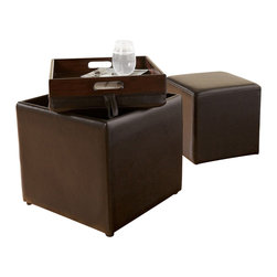 "Signature Design by Ashley - Cubit Storage Ottoman w/ Tray Chocolate - Looking for the perfect contemporary accent piece that is sure to enhance your living area? Look no further than the rich style of the ""CUBIT"" ottoman.The Cubit Accent Ottoman by Famous Brand Lamps is the perfect combination of style and function. Covered in stylish faux leather upholstery. The storage ottoman contains a smaller one that further accents your home. With a removable top that flips to reveal a functional tray and ample storage space when the cube ottoman is removed"