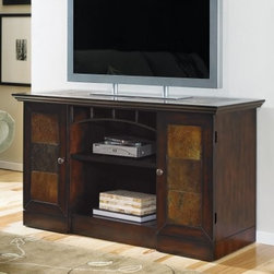 Hammary Vecchio Mid-Tone Brown Entertainment Console - Place your precious plasma on the Hammary Vecchio Mid-Tone Brown Entertainment Console and feel proud. Warm shades of brown wood create an authentic vibe, accented with an iron arch and inset slate tiles. Made with select hardwoods and veneers, it can hold most television screens up to 48 inches. A wire management hole in the open center area lets you manage your components neatly.Dimensions:Overall Dimensions: 46W x 20D x 28H inchesBehind door: 10W x 17D x 23H inchesCenter compartment: 27W x 17D x 18H inchesAbout Hammary Furniture CompanyHammary Furniture Company was started in 1943 by furniture craftsman, Hamilton Bruce. The name Hammary is a combination of Hamilton and Mary (Hamilton's wife's name). Hammary is now a division of La-Z-Boy Incorporated and they specialize in providing quality home furniture for today's modern families and homes. Hammary offers a variety of occasional table styles, and other furniture for home office, casual dining, and bedroom in all shapes, sizes, and materials.