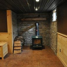 Rustic Basement by Eppinette Construction LLC