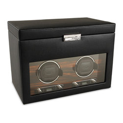 Frontgate - Double Watch Winder with Storage - Enlarged drum easily holds the largest of timepieces. Backlit LCD display lights up with your touch. You select turns per day, from 300 to 1200 in increments of 50. Easy directional control clockwise, counterclockwise, or bi-directional. Power reserve start delay from 6 to 72 hours (in increments of 6 hrs.). The design of our Roadster Watch Winders is inspired by the luxurious wood veneer dashboards that embody a luxury automobile. This exclusive collection of winders features wood veneer detailing on the front faceplate around the drums, and a black pebble finish exterior. . . . . . Rotation countdown display shows where your winder is in its cycle. Sturdy wooden frame. Metal hinges are recessed with integrated 90 degrees lid stoppers. Lockable glass front cover. Operates with 3.3V adapter (included) or D batteries.