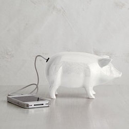Ceramic Pig Speaker - Chinese and European cultures see the pig as good luck and often depict them on charms or tokens. This ceramic white pig is actually a speaker that connects with your MP3 player. It can pull double-duty as a cute sculpture too, while still being discreet about its speaker capabilities.