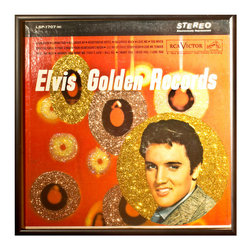 """Glittered Elvis Golden Records Album - Glittered record album. Album is framed in a black 12x12"""" square frame with front and back cover and clips holding the record in place on the back. Album covers are original vintage covers."""