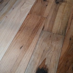 The Barn Star Wood Flooring Collection - Whiskey 118, engineered 4mm American Hickory wood flooring from the Barn Star Collection | Eastern Star Wood Floors. Floor features a non-toxic 9-coat German finish and a multi-generational wear layer that can be sanded and refinished up to 3 times.