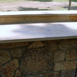 """Outdoor Kitchen by DYI - Indoors Out - An outdoor kitchen installed by Dean & Derek from DIY Network.  The flagstone patio and """"webwall"""" on the kitchen units is Carmel Gray Flagstone.  Countertop is natural quarried 2 1/4"""" sandstone slabs.  Stone provided by Sturgis Materials."""