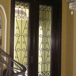 Solid Mahogany 10' Feet Double Entry Doors with Wrought Iron Grills - Solid mahogany wood 10' feet tall double entry doors with decorative wrought iron grills with spraylite glass.
