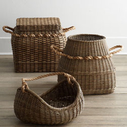 Rattan Baskets - Woven baskets in various shapes and sizes always soften a room. These would be great for gathering toys, firewood or rolled-up blankets.