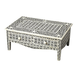 Butler Specialty - Butler Cassandra Black Bone Inlay Cocktail Table - The captivating pattern on this black and white cocktail table features sophisticated artistry. Including two drawers for convenient storage, the botanic patterns adorning this piece are created from white bone inlays cut and individually applied with the iridescence of natural bone against a striking black background. No two tables are ever exactly alike, each are uniquely handcrafted.