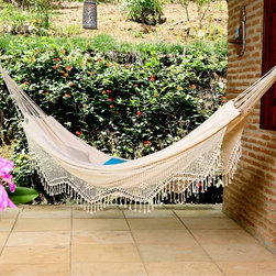 Island Bay - Hammock: XL Brazilian Fabric Hammock with Fringe - Shop for Hammocks from Hayneedle.com! Spacious Cozy EleganceMade from 100% soft stretchy cotton fabric this traditional natural colored Brazilian hammock is cozy enough for one and spacious enough for two. Many people prefer the closed weave of these hammocks for sleeping and overnight use because they retain heat and feel quite secure. This fabric is excellent for cooler climates and mild weather use. The elegant appearance is attractive both indoors and outdoors. The hammock is edged in beautiful handwoven fringe characteristic of hammocks from Brazil. Many of our customers who have traveled abroad have loved the style of Mayan Nicaraguan and Brazilian hammocks because of their high comfort level. These hammocks are often used as beds so feel free to use them to their full potential. Order this hammock and stretch out with stylish comfort!