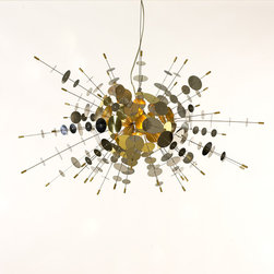 Confetti Pendant - This fixture is made of bright golden brass circular pieces projecting out like a Sputnik. It is fanciful and and original and would make a wonderful fixture over a dining room table. Or use it as a center fixture in a master bedroom. I've seen it in person, and it is really quite spectacular.