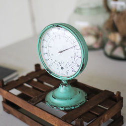 Vintage-Inspired Thermometer - Check your bathroom's steam levels with this vintage-inspired thermometer. Its distressed base and antique face have a timeless appeal.