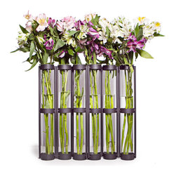 Danya B - Tall Metal Hinged 6-glass Vial Vase - This hinged vase with six glass vials on a metal stand is easy to arrange. Hinges allow you to set vase straight or wrapped around to achieve different effects. Now anyone can crate beautiful arrangements to go on a mantel or buffet table.