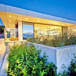 Contemporary Home-1 Solana Beach California - Trex smooth panel exterior with large Fleetwood sliding glass doors and glass rail and pervious pavers.  Design by San Diego architect Ted Schultz.