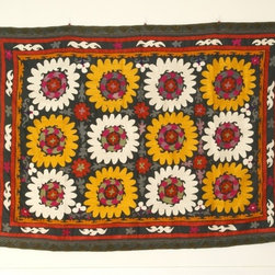 Soliha's Suzani - I've always had a soft spot for suzani tapestries. They are not only beautiful to look at, but very versatile as well. Use them as wall art, bedding or an occasional rug.