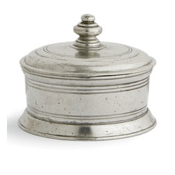 Roma Small Round Box - The Roma Small Round Box is an unmistakably European accent in vintage pewter, its symmetrical turns and simply cut-in decorative rings accenting a pared-down shape.  The high knob in the center of the lid allows lifting of the lid.  The materials of this metal trinket box are the finest that traditional craftsmanship has to offer � traditional Italian pewter and mouth-blown glass � and the quality of these elements shows even in such a small home accent.